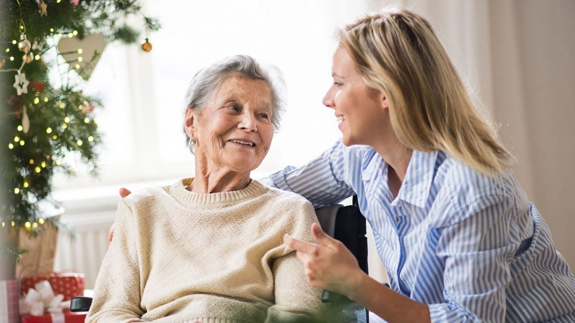 Senior woman talking with her home health aide.