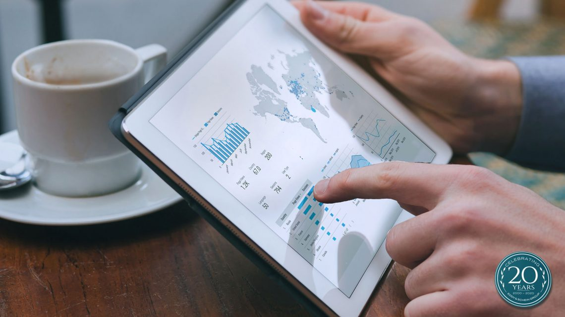 Eddy & Schein Group millennial investing in stock market using ipad.