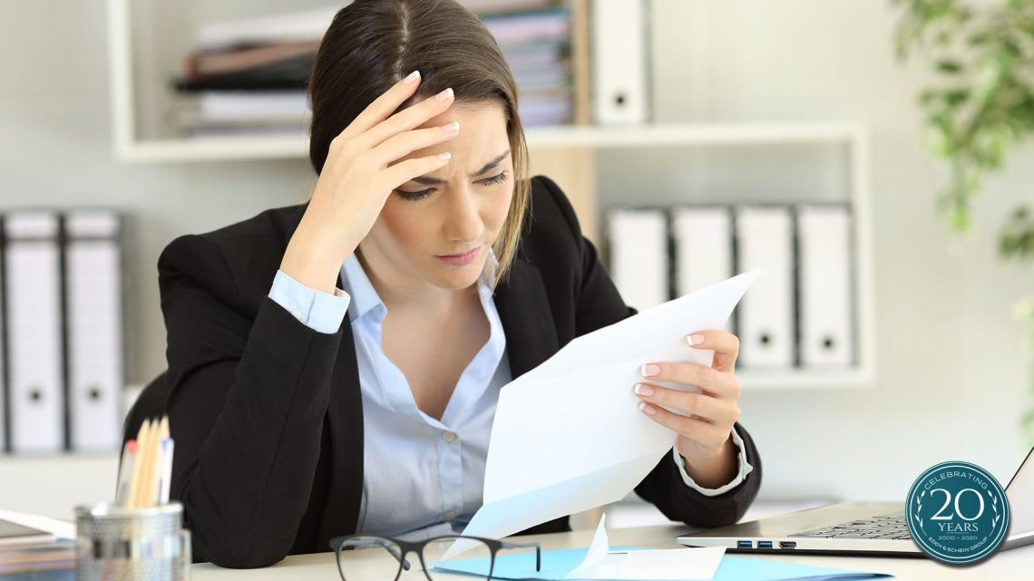Woman confused when reading financial and tax documents