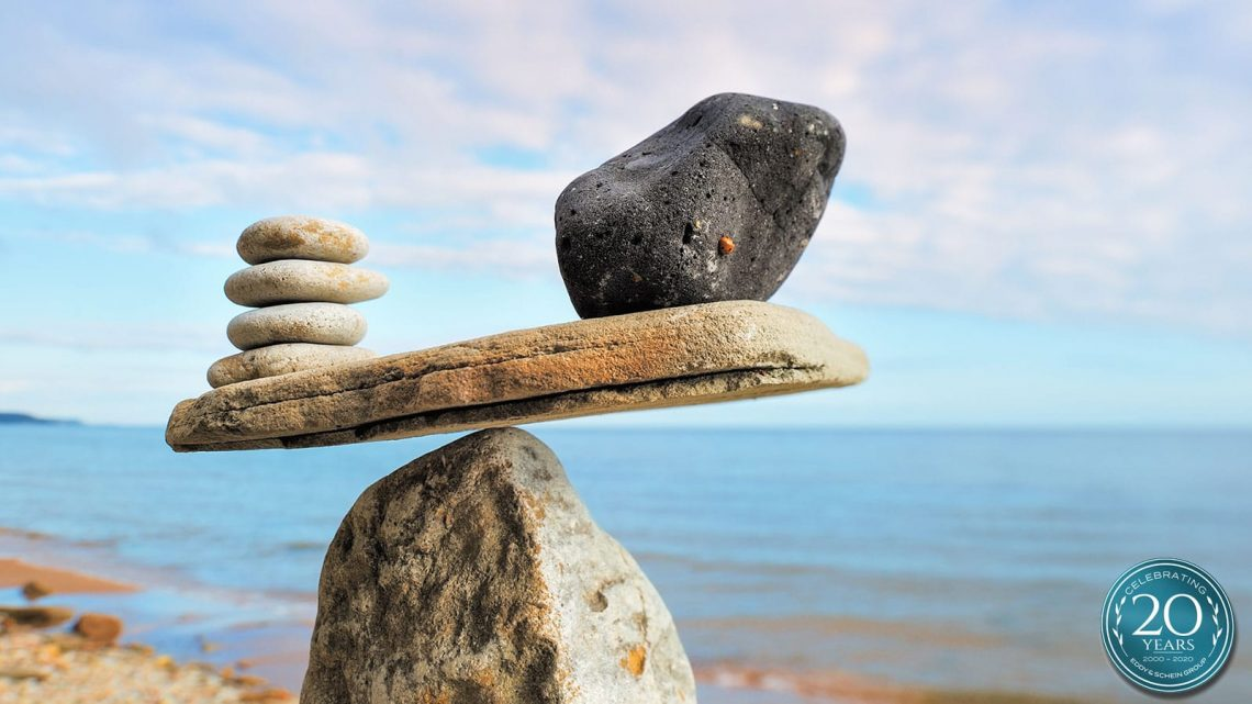 Eddy And Schein Stone Scale Balance Shutterstock 272045705 20th Logo