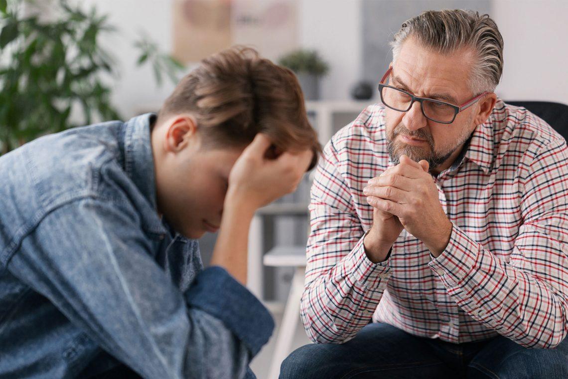 Eddy And Schein Talking To Son Finances Shutterstock 1659333346